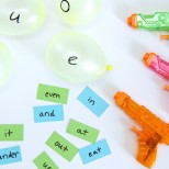Water Balloon Vowel Game-how fun is this idea to keep kids in the learning mode all summer